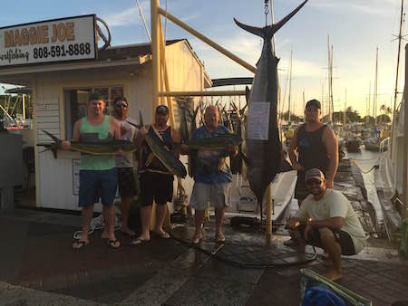 Corey  with his blue marlin on ruckus with Matt and chip  18mahi