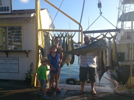 Gordon, Sara, Emma, and Ethan on Maggie with Capt Mark and Ty  3 stripped marlin and 18 mahi1