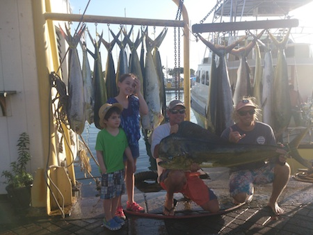 Gordon, Sara, Emma, and Ethan on Maggie with Capt Mark and Ty  3 stripped marlin and 18 mahi2