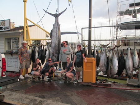Angler Nathan with 550 lb Blue Marlin, 24 Shibi and 1 Rainbow Runner