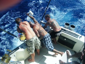 The guys trying to haul in the 606 lb Marlin - not an easy task
