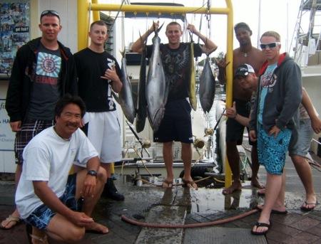 2011-02-12-sea-hawk-captin-darrel-and-mate-shown-with-2-mahi-mahi-and-3-yellow-fin-55lbs-one-alan-john-braden-james-michael