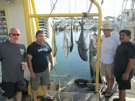 Frank, Tim, Romeo and Raymond with 2 Mahi Mahi and 2 Ulua