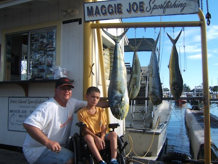 maggie-joe-4-mahi-anger-kyle-and-his-dad-matt-caught-bait-fish-that-helped-bring-in-the-mahi